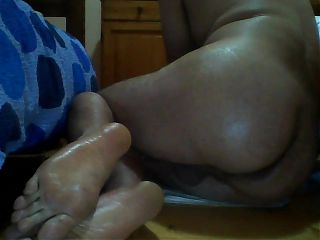 Anal toying oiled ass and feet