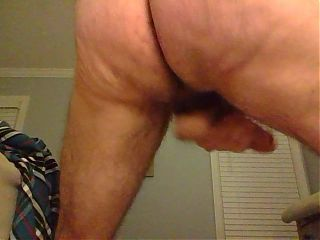 Rear view of wank - swinging balls and ass