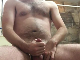 bearded guy cums in bathroom